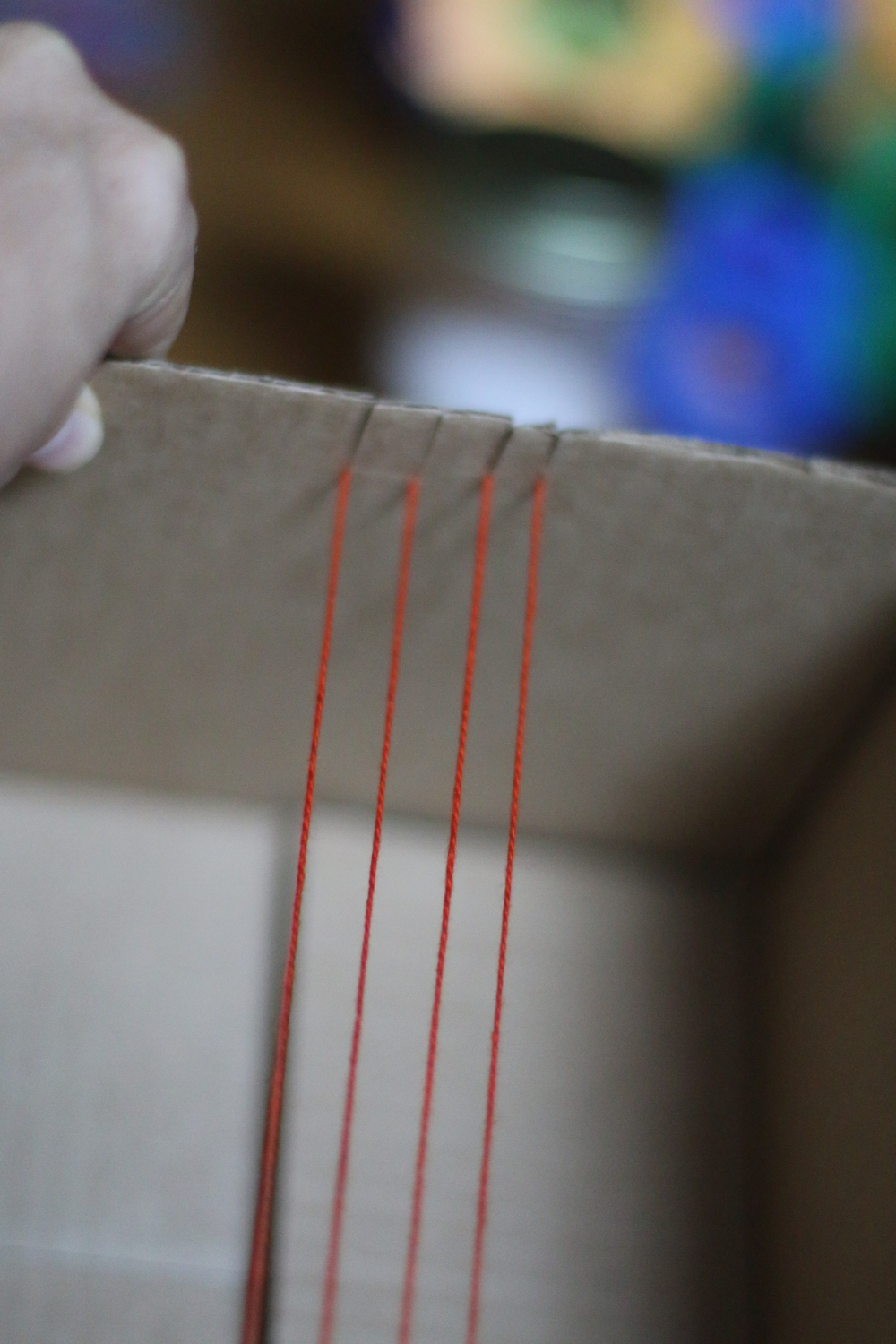 a prepared cardboard box loom for a Native American inspired beading project for homeschooling