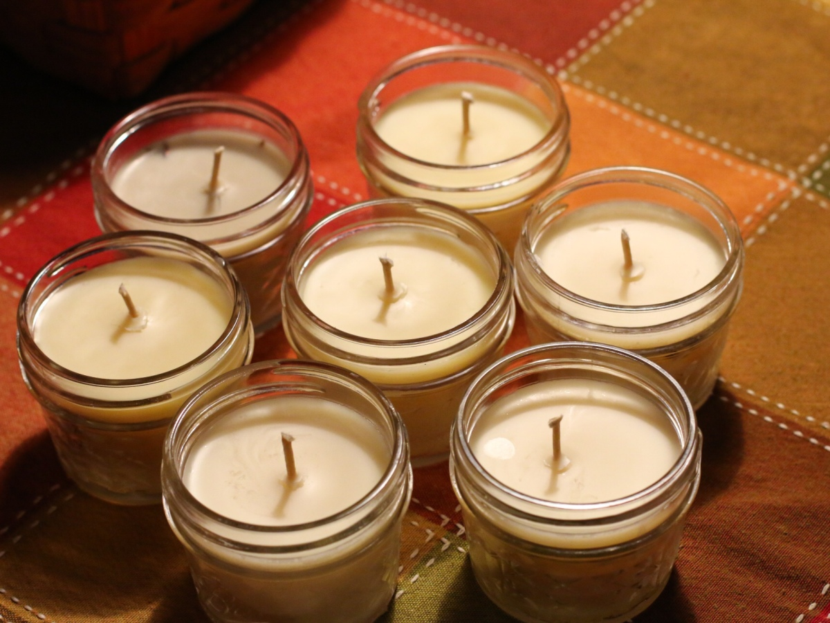 Several Beeswax candles in a mason jar